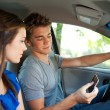 Driving: Reading a Text Message While Driving — Stock Photo