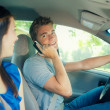 Driving: Teen Male on the Phone While Driving — Stock Photo