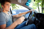 Driving: Trying to Text and Drive — Stock Photo