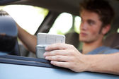 Driving: Focus on Cell Phone — Stock Photo
