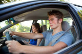 Driving: Driver Paying Attention While Passenger Texts — Stock Photo