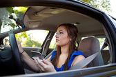 Driving: Woman Reading Directions — Stock Photo