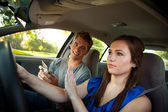 Driving: Driver Ignores Friend with Phone — Foto de Stock
