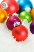 Christmas: Christmas Tree Ornaments In Snow — Stock Photo