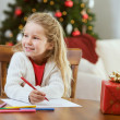 Christmas: Little Girl Writing Letter To Santa Claus — Stock Photo #32969305