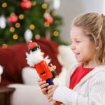 Christmas: Girl Giggles At Nutcracker Doll — Stock Photo
