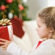 Christmas: Girl Thinking About Christmas Gift — Stock Photo