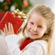Christmas: Cute Girl with Christmas Gift — Stock Photo