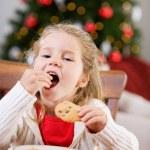 Christmas: Little Girl Eating Santa's Cookies — Stock Photo