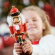 Christmas: Little Girl Holding Up Traditional Nutcracker — Stock Photo