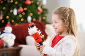 Christmas: Girl Giggles At Nutcracker Doll — Stock Photo