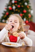Christmas: Little Girl Eating Santa's Cookies — Stock Photo