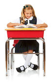 Student: Girl At Desk Reading Book — Stock Photo