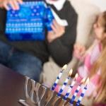 Hanukkah: Father Opens Hanukkah Gift — Stock Photo