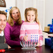 Hanukkah: Family Holiday Portrait with Menorah — Stock Photo #33346129