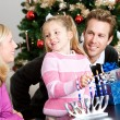 Stock Photo: Holidays: Fun Family Time Lighting Menorah