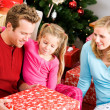 Stock Photo: Christmas: Family Opening Christmas Presents