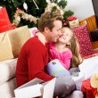 Christmas: Girl Thanks Father For Gift — Stock Photo