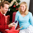Christmas: Man Gets New Camera For Christmas — Stock Photo #33347511