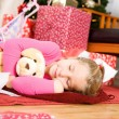 Christmas: Girl Asleep After Opening Presents — Stock Photo #33347641