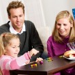 Hanukkah: Family Playing Dreidel Game for Hanukkah — Stock Photo