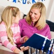 Hanukkah: Girl and Mother Read Story — Stock Photo