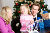 Holidays: Fun Family Time Lighting Menorah — Stock Photo