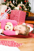 Christmas: Girl Asleep After Opening Presents — Stock Photo
