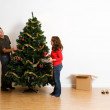 Christmas: Adding Ornaments to Tree — Stock Photo