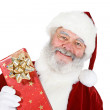 Santa: Holding a Wrapped Gift — Stockfoto