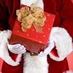 Santa: Hands Full Of Christmas Presents — Stock Photo