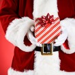Santa: Hands Full Of Christmas Presents — Stock Photo #33800397