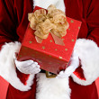 Santa: Hands Full Of Christmas Presents — Stock Photo #33800435