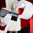 Santa: Pulling Cash Out Of Wallet — Stock Photo #33800491