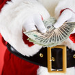 Santa: Holding Out A Money Fan — Stock Photo #33800523
