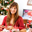 Christmas: Woman Having Fun Wrapping Baked Goods — Stock Photo