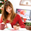 Christmas: Writing Holiday Cards at Table — ストック写真