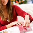 Christmas: Woman Wrapping Small Gift — Stock Photo #33801661