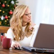 Christmas: Thinking About Online Purchase — Stock Photo