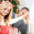Christmas: Woman Trying To Wrap Present — Stock Photo