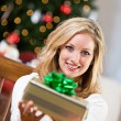 Christmas: Pretty Woman Getting Gift Ready — Stock Photo