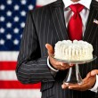 Politician: Holding a Cake on Cake Stand — Stock Photo