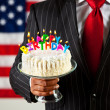 Politician: Cake with Birthday Candles — Stock Photo #33808393