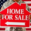Stock Photo: Soldier: Holding a Home for Sale Sign