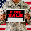 Stock Photo: Soldier: Holding Blank For Sale Sign
