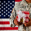 Stock Photo: Soldier: Holding a Wrapped Gift