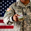 Soldier: Holding Out Cash — Stock Photo