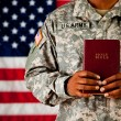 Stock Photo: Soldier: Holding a Bible in Front of Him