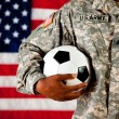 Stock Photo: Soldier: Holding a Soccer Ball