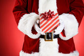 Santa: Hands Full Of Christmas Presents — Stock Photo